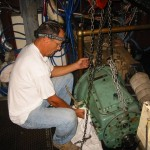 5-26 Capt._Bill_Repairing_an_800_pound_Transmission_in_the_wilderness_ofBaja[1]